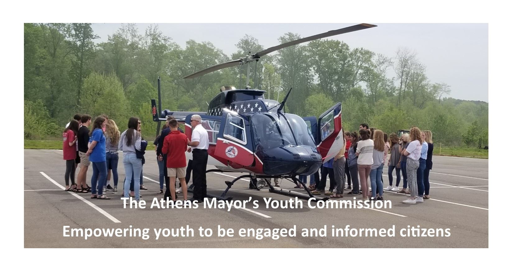 Youth Commissioners check out a medical helicopter