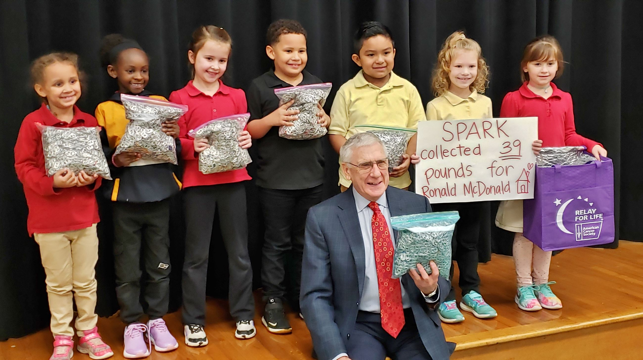First graders who collected cola tabs pose with Mayor Marks
